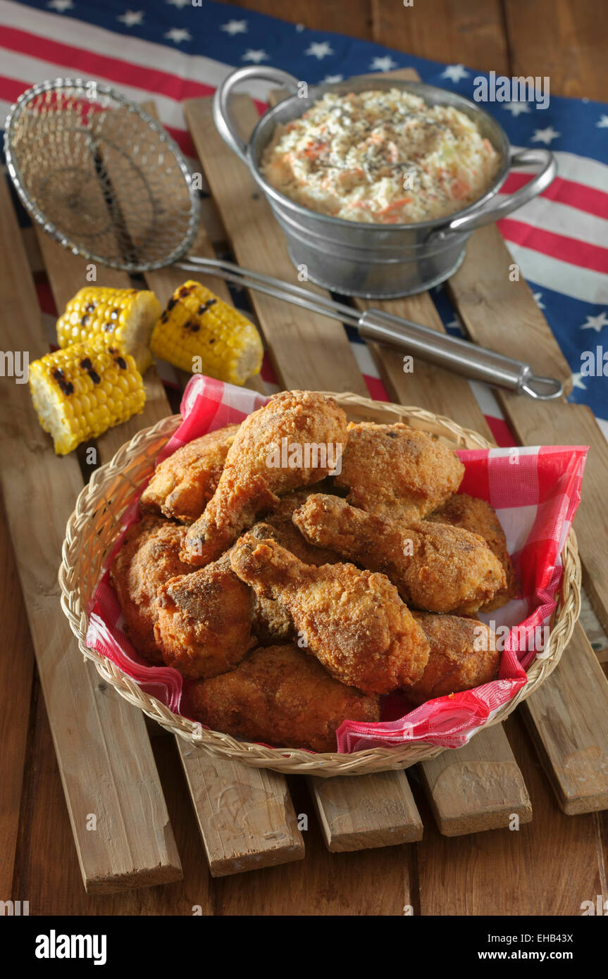 Southern fried chicken with coleslaw and grilled corn - Stock Image