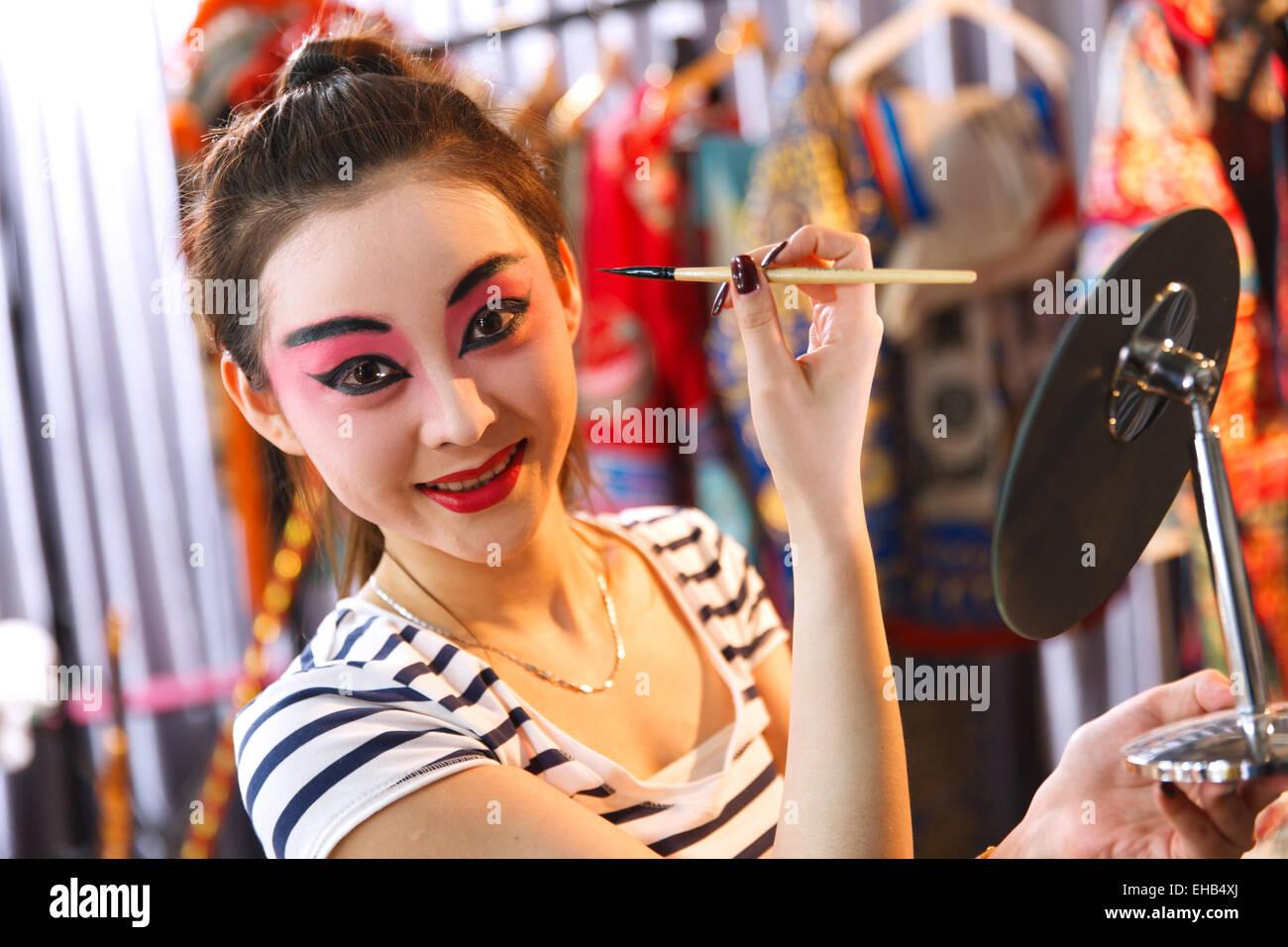 Beijing Opera actor are backstage makeup - Stock Image