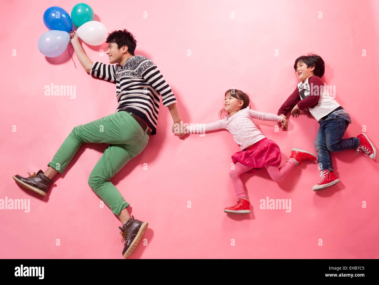 The father took his son and daughter to play - Stock Image