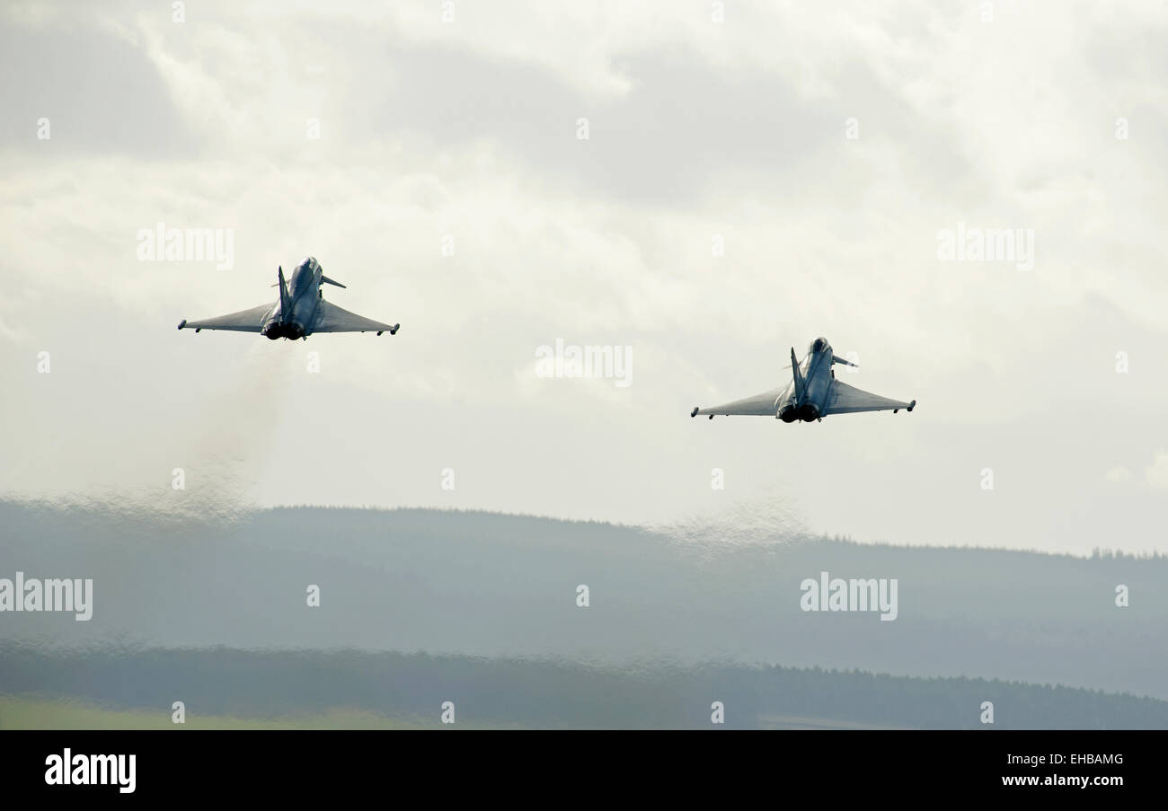 A paired take off for two RAF Eurofighter Typhoon FRG4s from Lossiemouth air station in Moray, Scotland.  SCO 9634. - Stock Image