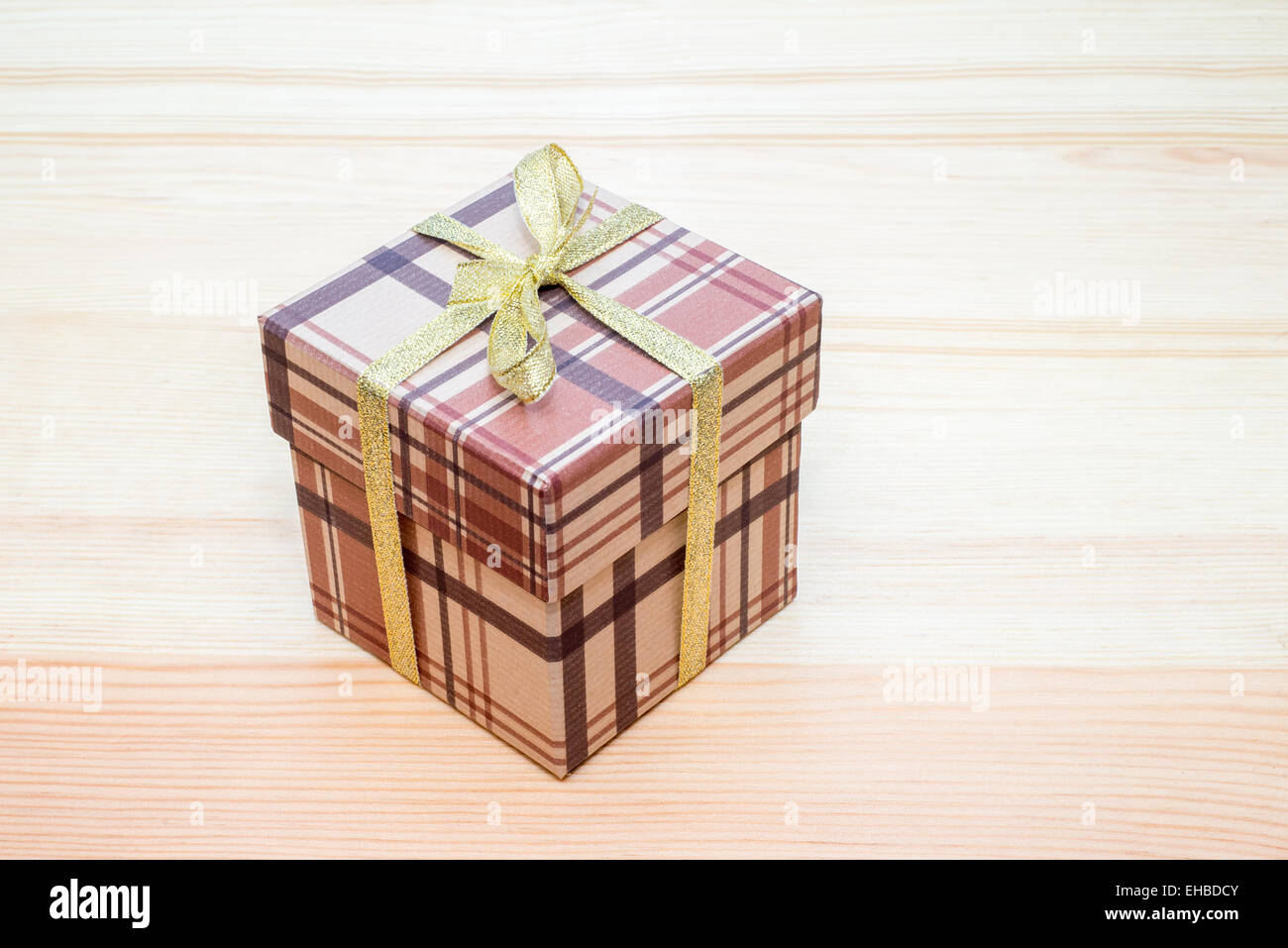 brown gift box with bow on wooden table Stock Photo