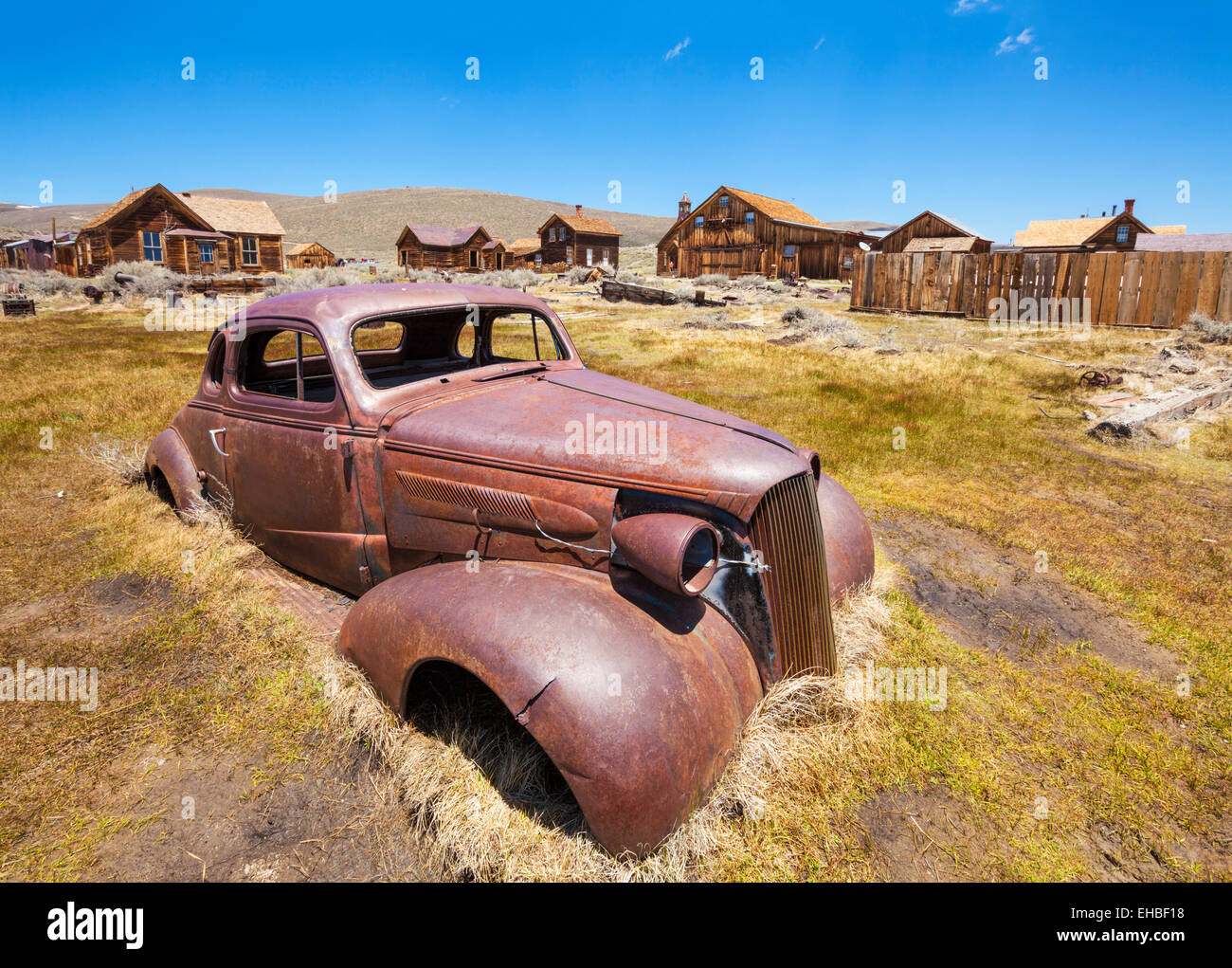 Rusting car in Bodie ghost town Bodie State Historic Park California USA United States of America - Stock Image