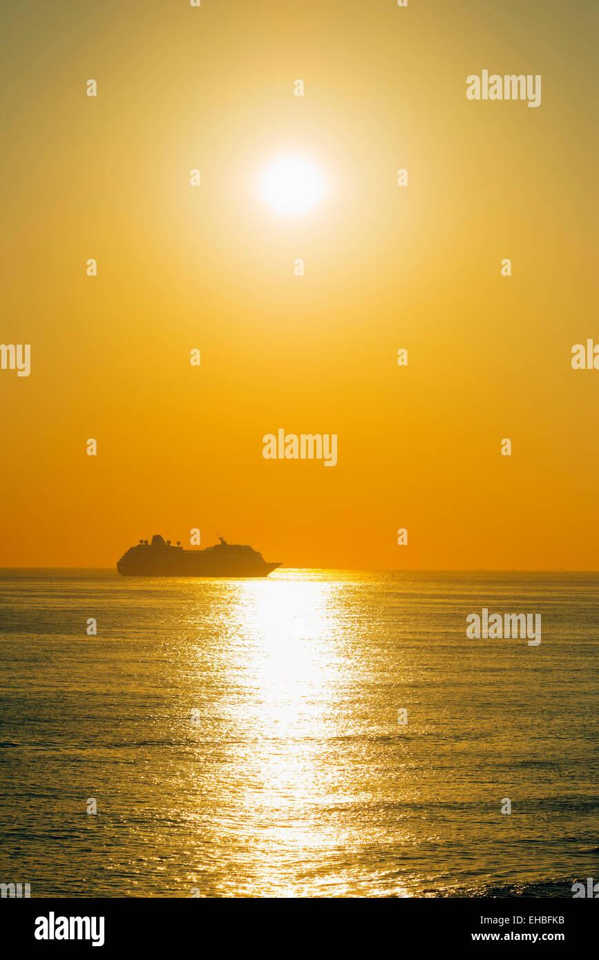 Mediterranean Europe, Malta, Sliema waterfront, cruise liner at sunrise - Stock Image