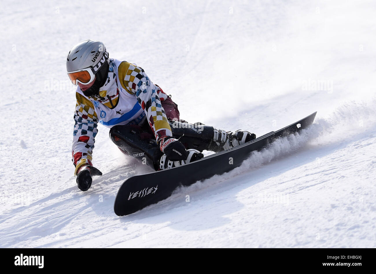 Yabuli Town, China. 11th March, 2015. Dmitry Sarsembaev of Russia competes during the Men's Giant Slalom match on Stock Photo