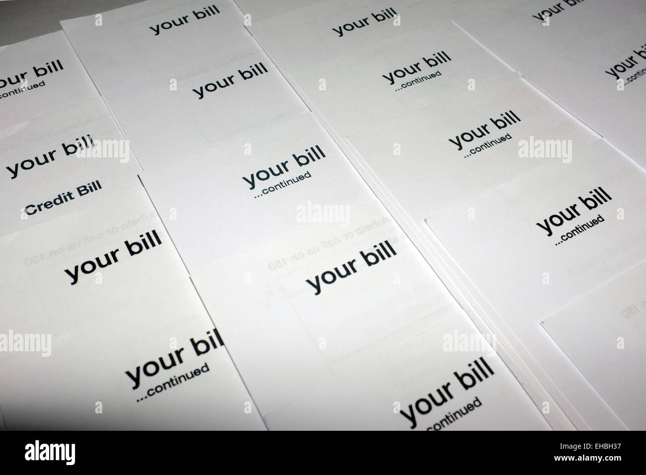 A collection of bills sent via post. - Stock Image