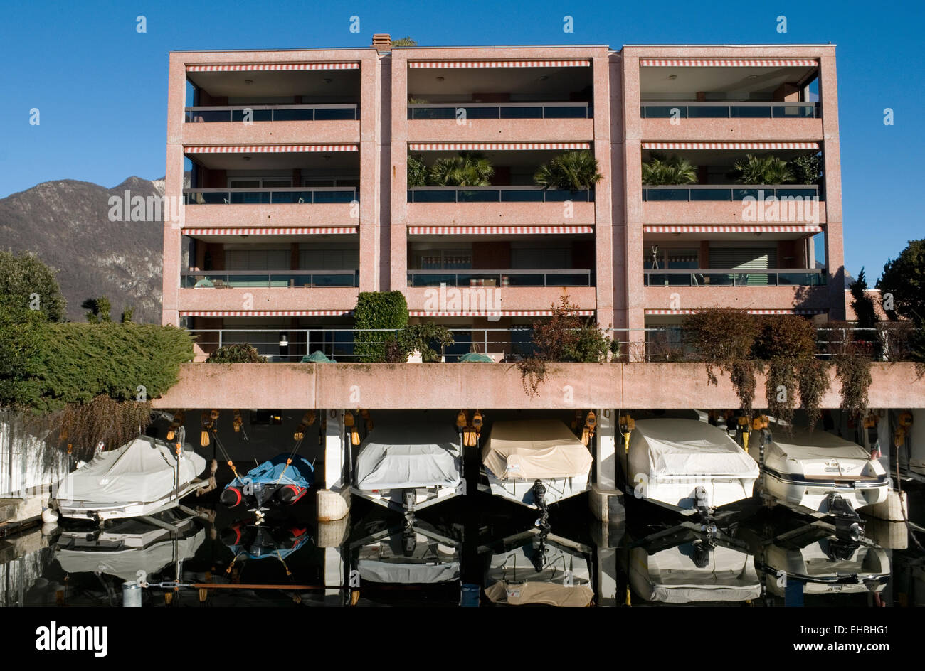 lakefront luxury apartments  with own mooring, Melide, Lake Lugano, Switzerland - Stock Image