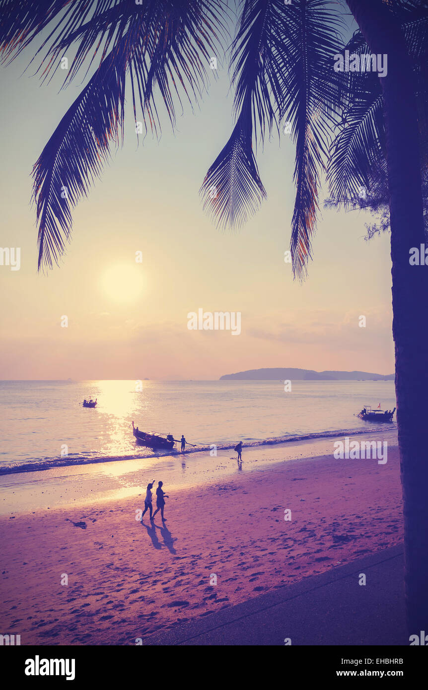 Retro instagram style filtered picture of beach at sunset. - Stock Image