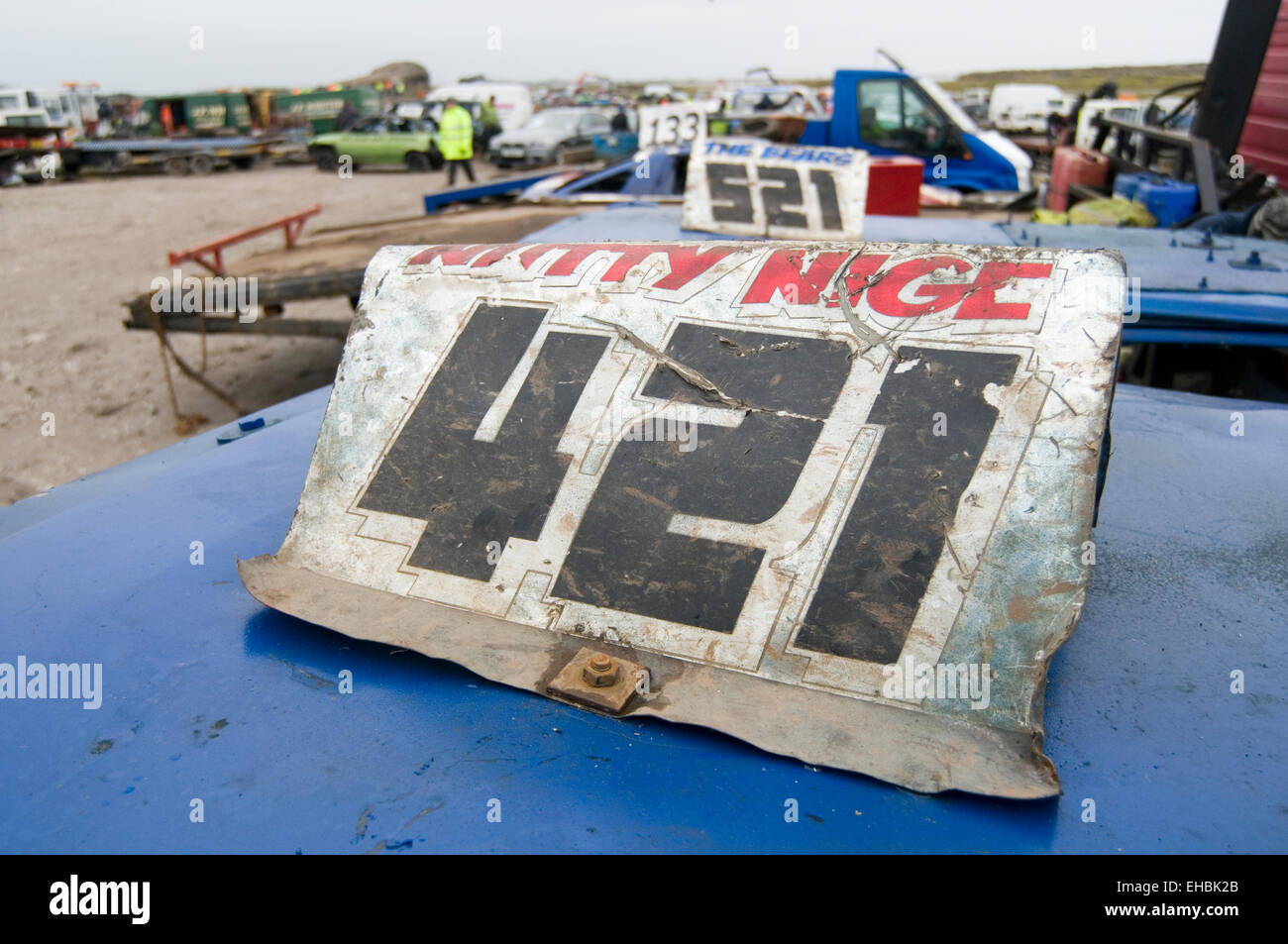 roof mounted fin plate on demo derby car with the drivers identifying race number on - Stock Image