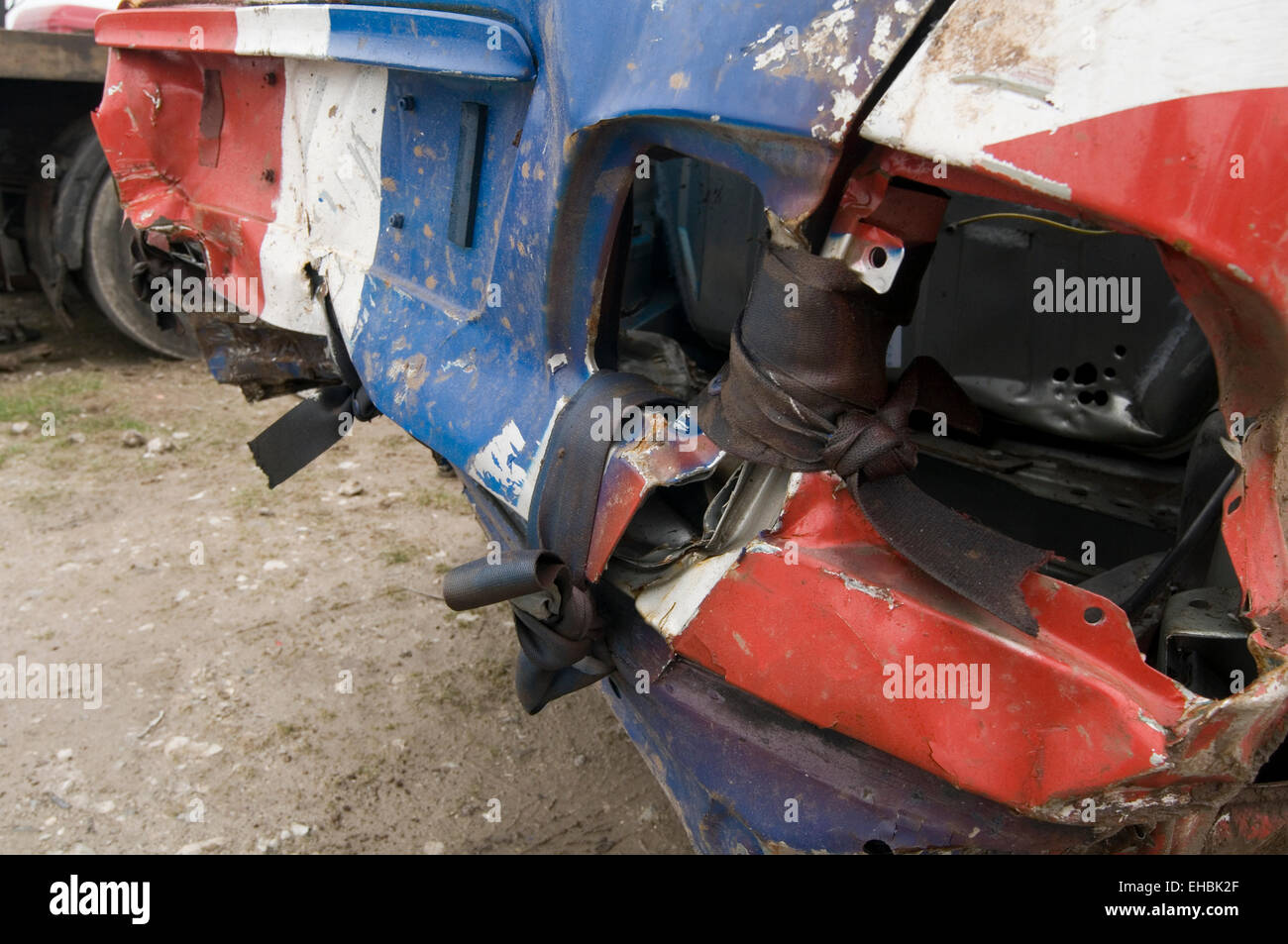 seat belt belts seatbelts seatbelt material used to tie the boot shut on demolition derby demo derby car smashed - Stock Image