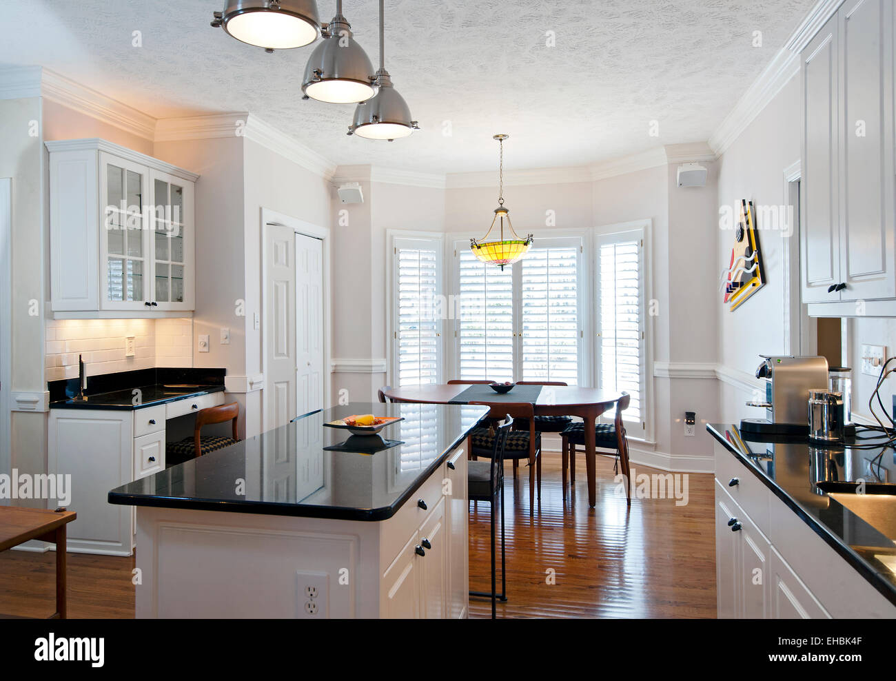 Modern residential furnished kitchen with center island in a single family house - Stock Image
