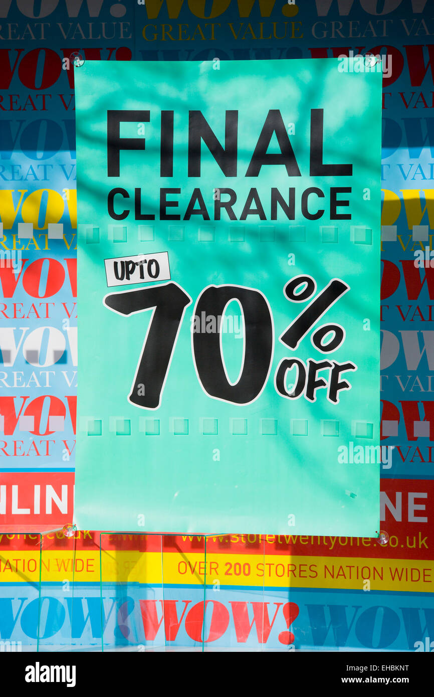Business, Shops, Shopping, Final Clearance Sale sign with up to 70% off in the window of a high street shop. - Stock Image
