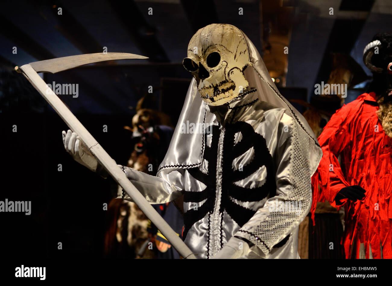 Death Costume Grim Reaper Devil or Satan with Scythe from Zielonki Carnival Poland - Stock Image