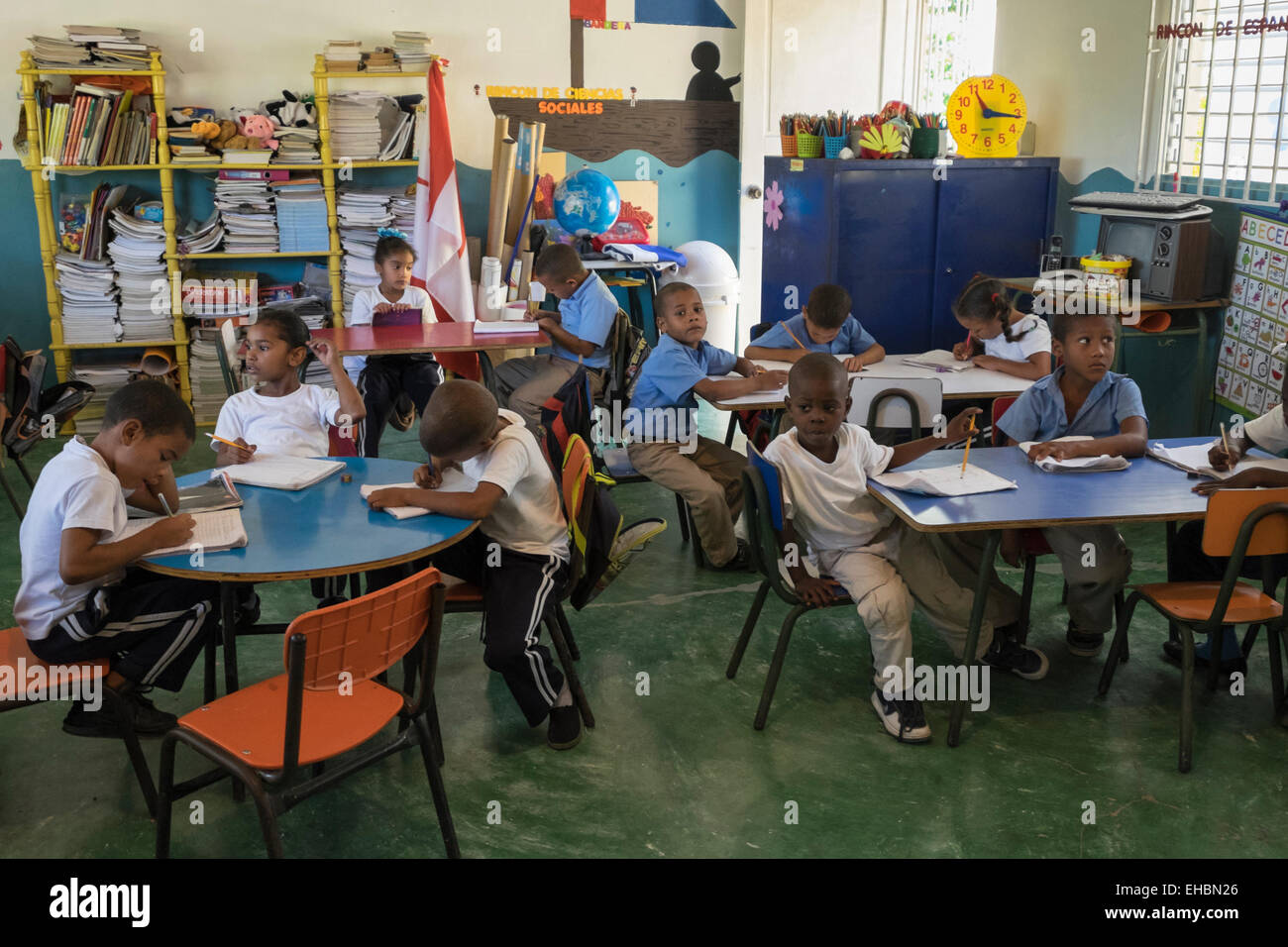 Primary school children studying in a classroom of village school near Puerto Plata, Dominican Republic, Caribbean - Stock Image