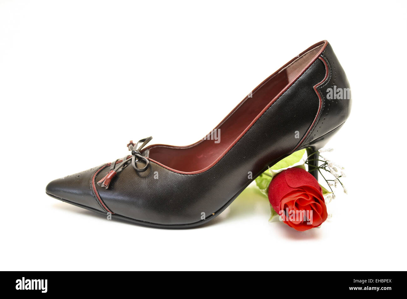 Ladies shoes with rose - Stock Image