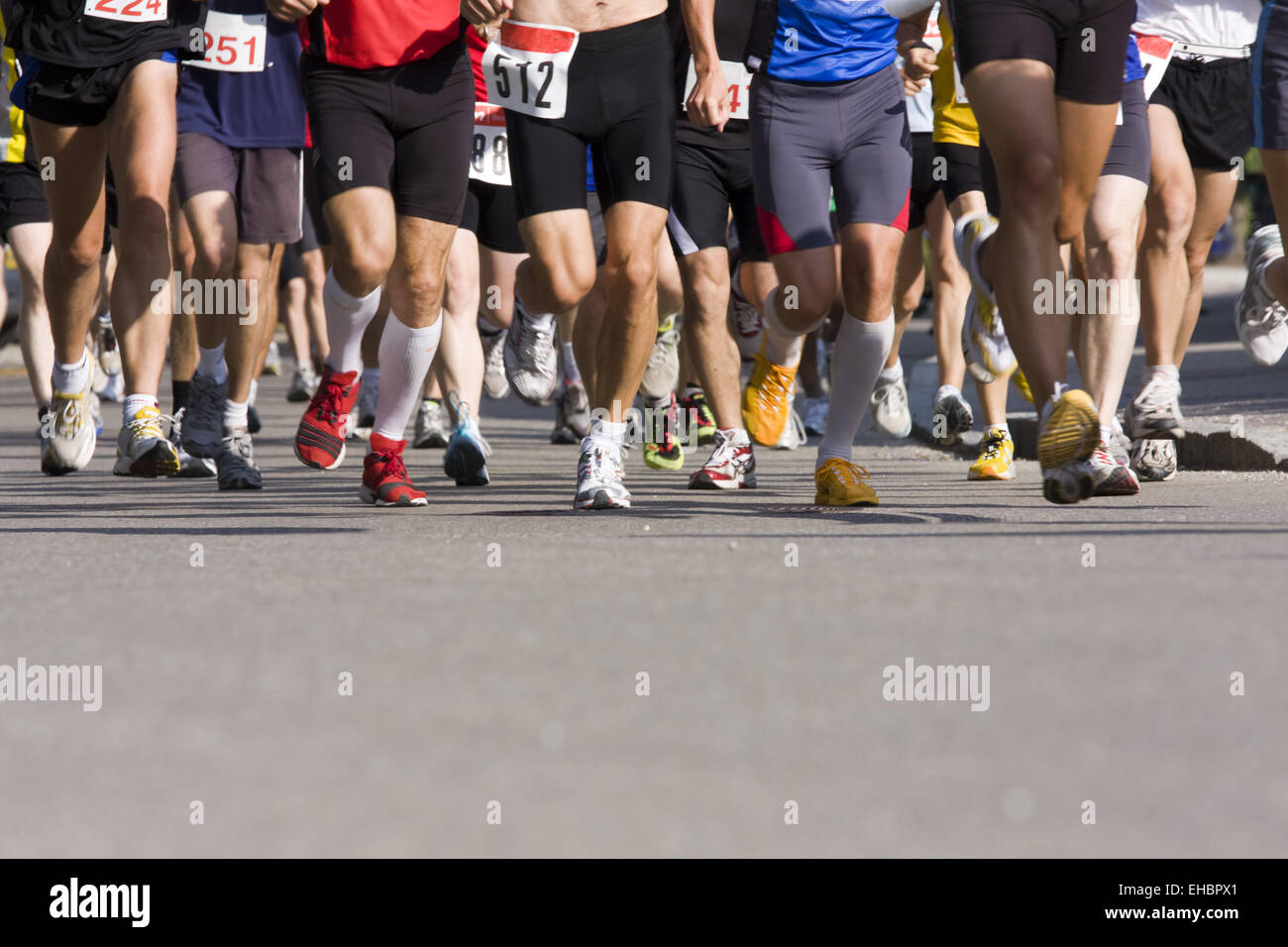 runners feet on asphalt - Stock Image