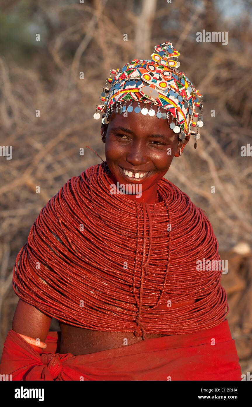 Smiling Samburu girl with huge beaded necklaces and headdress, Archer's Post area, Kenya - Stock Image
