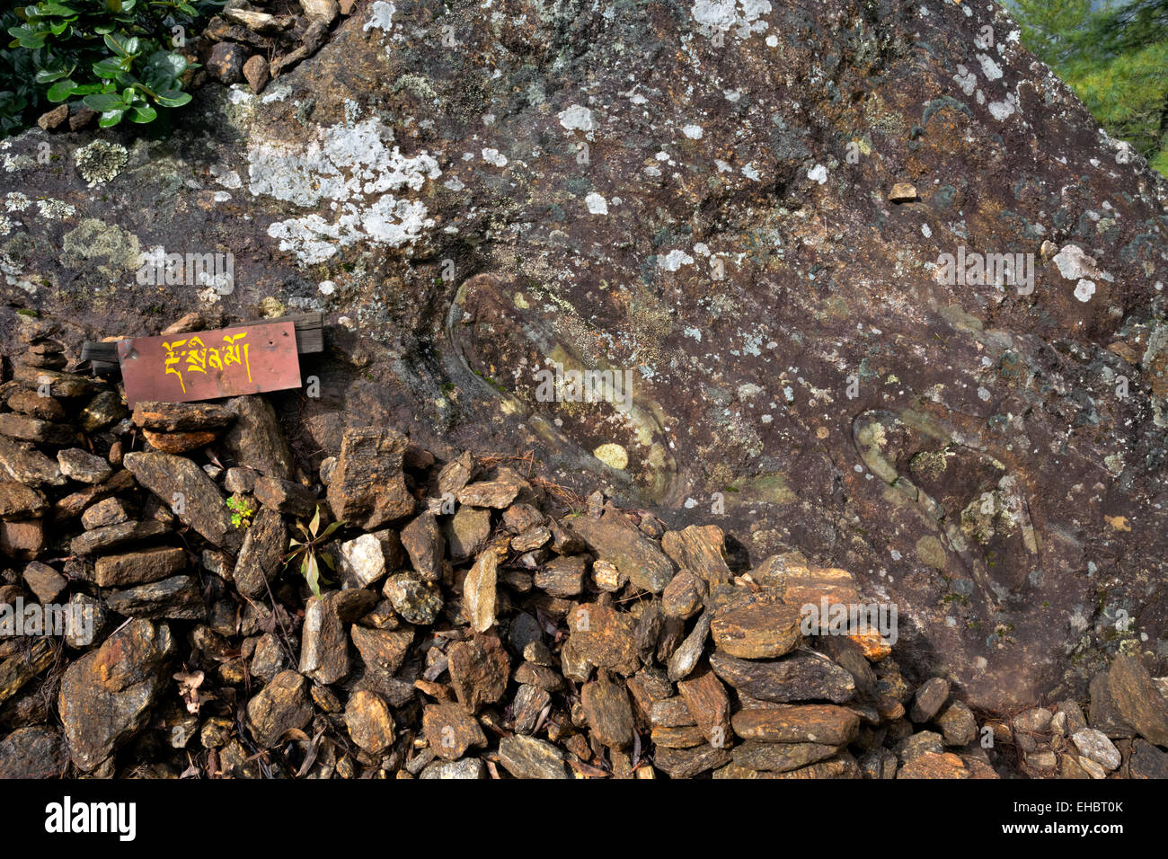 BHUTAN - Legend has it that these are footprints left by Guru Rinpoche who arrived the first time on a back of a - Stock Image