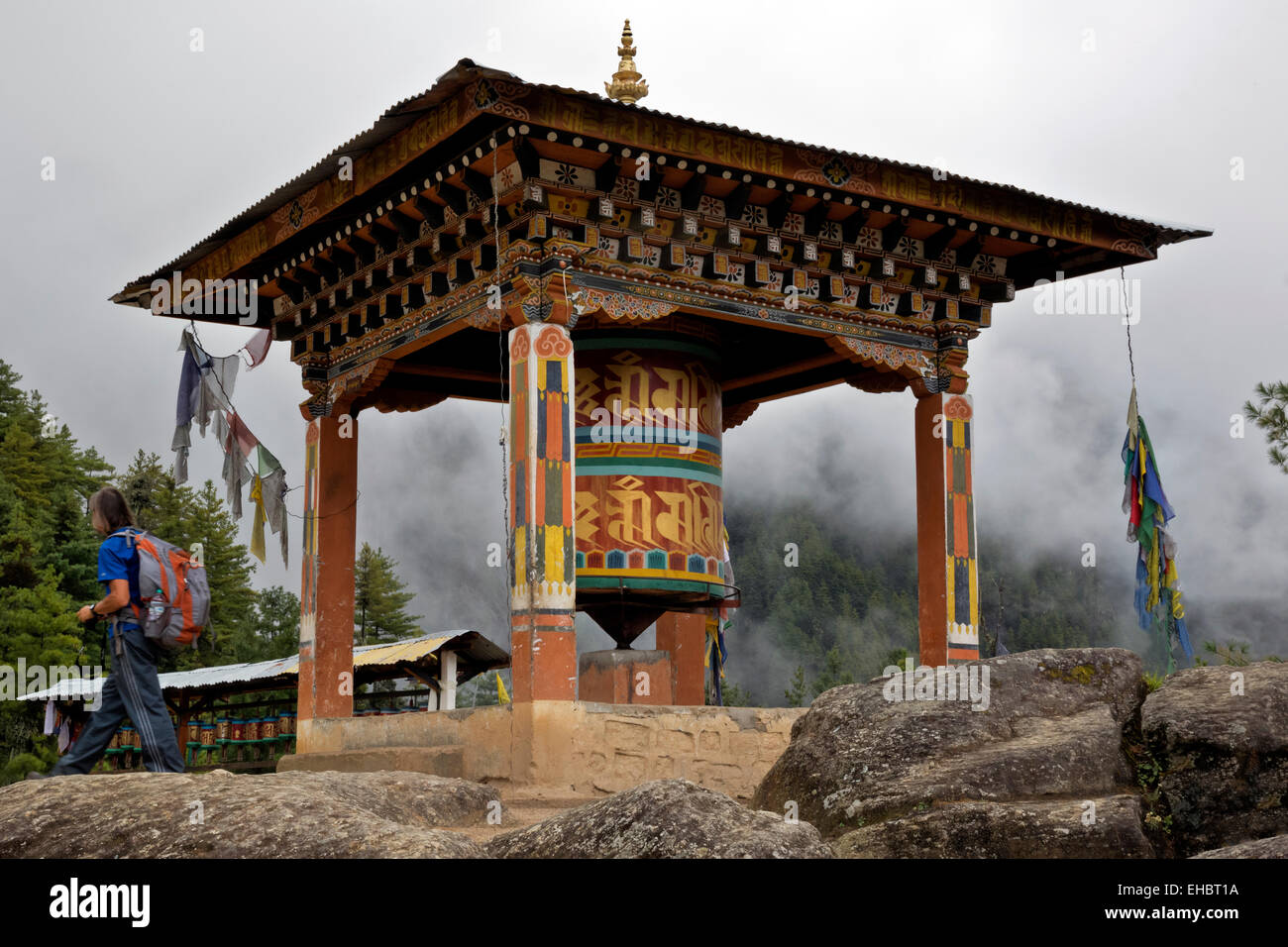BU00318-00...BHUTAN - Prayer wheels along the trail to Taktshang Goemba, (the Tiger's Nest Monastery). - Stock Image