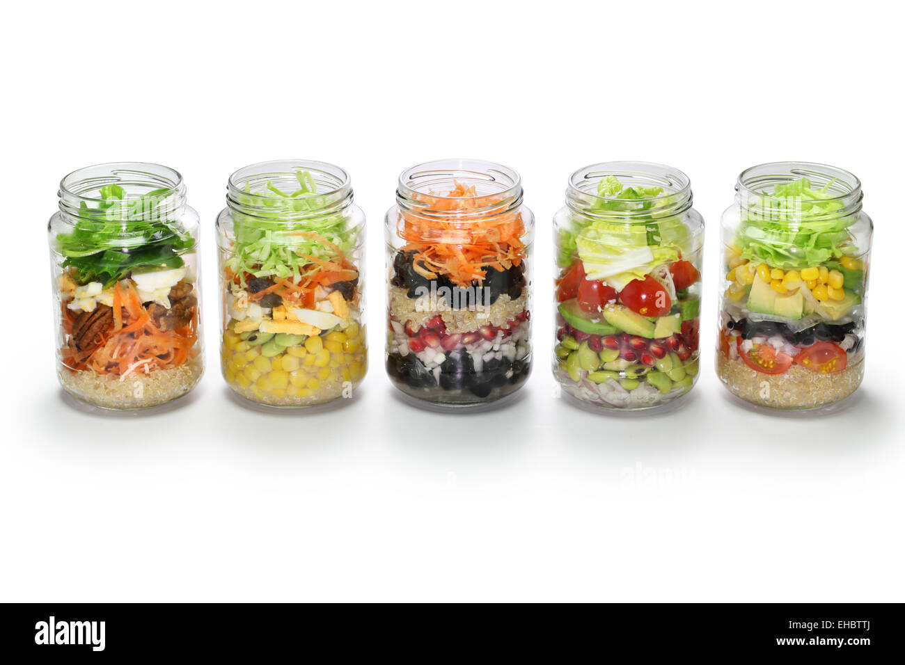 homemade vegetable salad in glass jar on white background - Stock Image