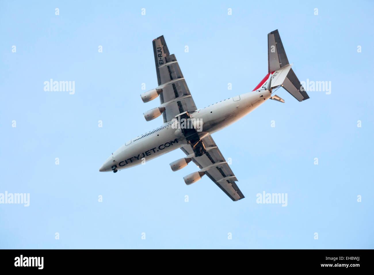 CityJet EI-RJU Cityjet British Aerospace Avro RJ85 plane flying overhead towards London City Airport - Stock Image