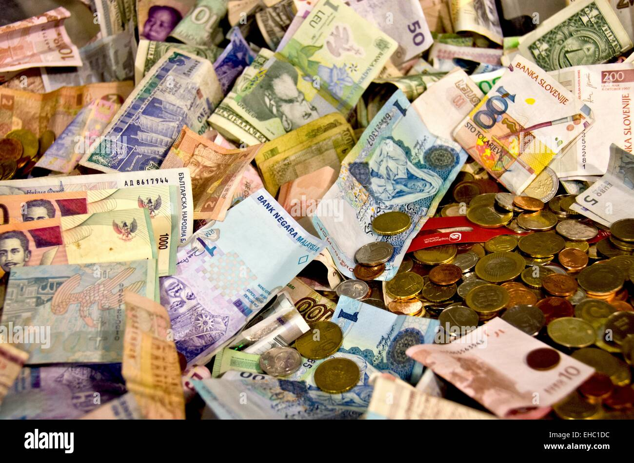 World different currencies coins and paper money. - Stock Image