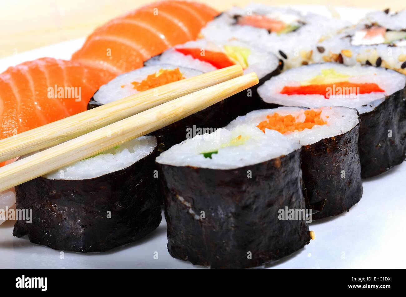 Sushi Meal Variety.sushi meal variety with chinese sticks next to them - Stock Image