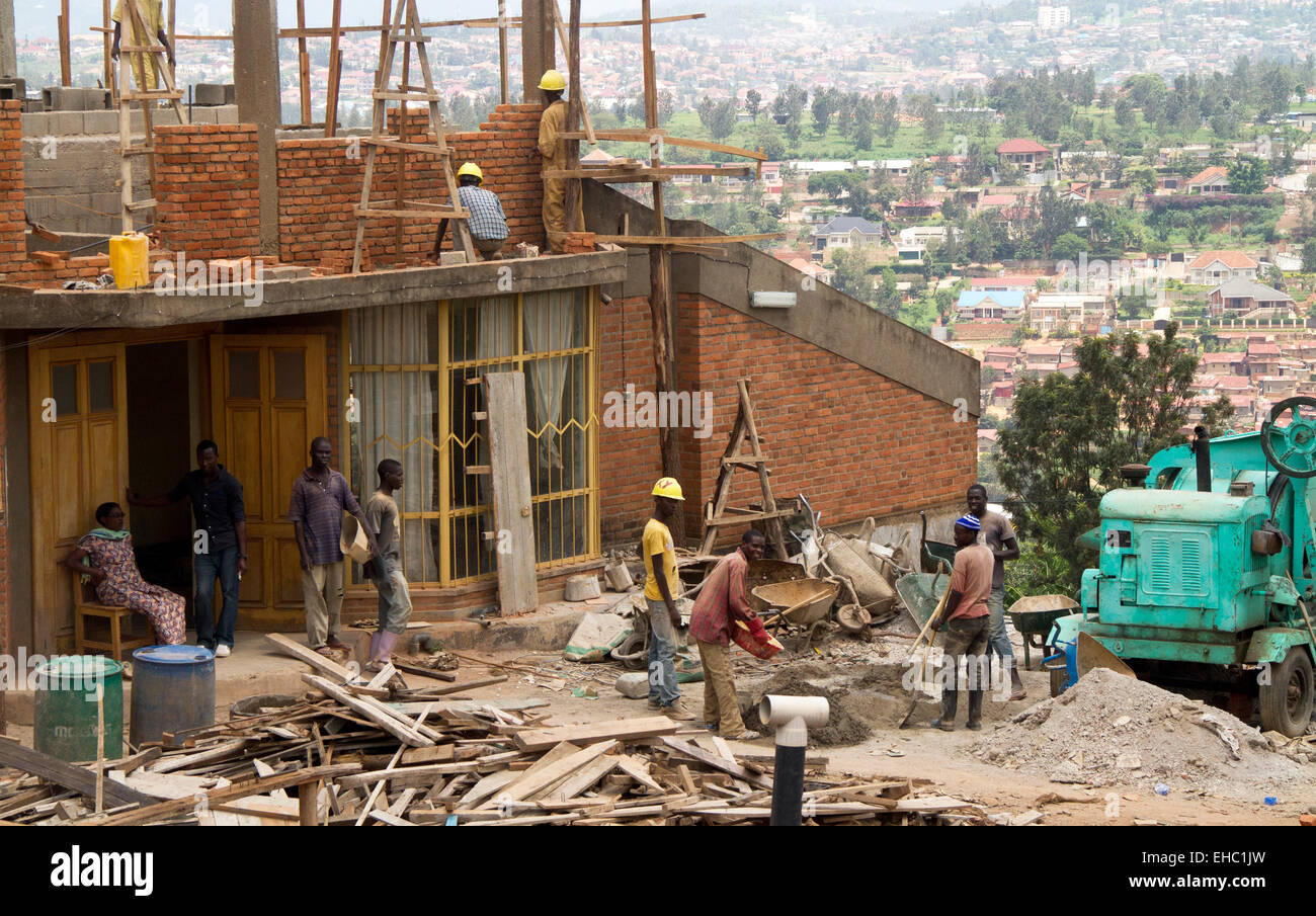 KIGALI, RWANDA - NOVEMBER 14, 2013: Unidentified men at work in the construction of a building in Kigali - Stock Image