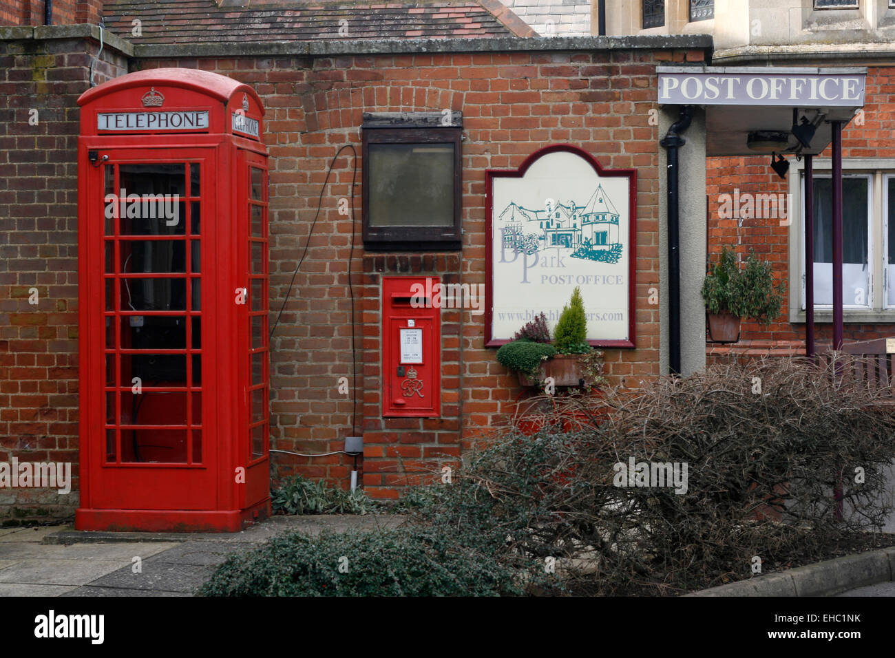 Bletchley Park Post Office with red telephone box Bletchley Buckingamshire England - Stock Image