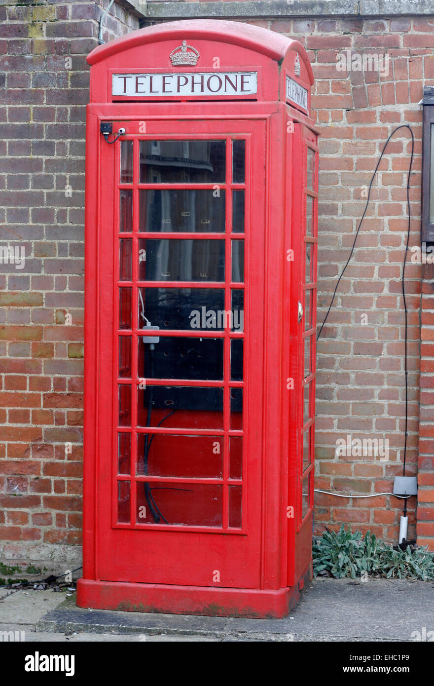 Red Telephone kiosk outside of Bletchley Park Post Office - Stock Image