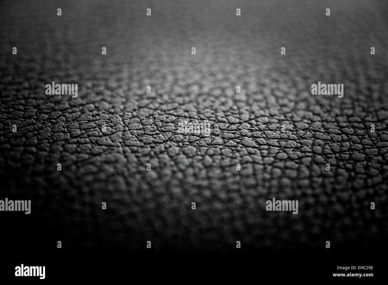 Black leather texture detail with shallow depth of field - Stock Image