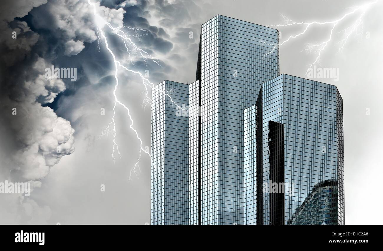 Financial and economic crisis concept with giant storm over financial buildings. - Stock Image
