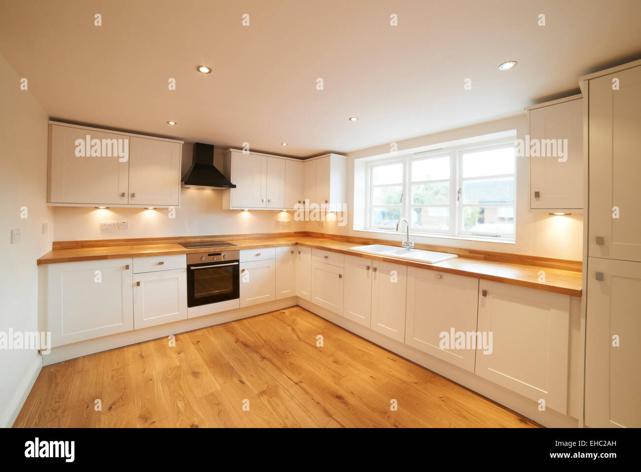 Beautiful Fitted Kitchen In Modern House - Stock Image