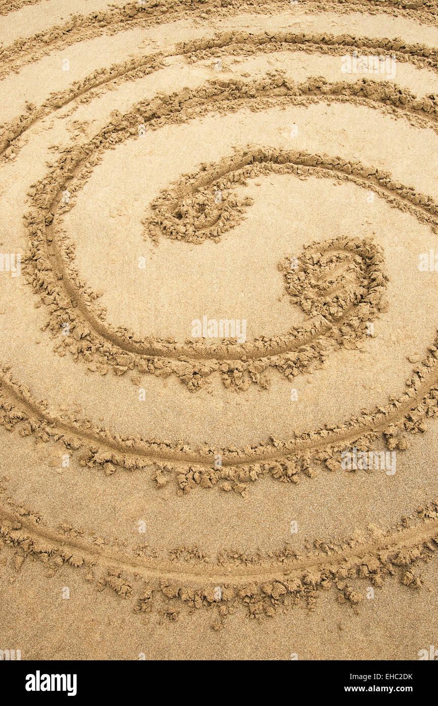 A circular detail of a beach maze - Stock Image