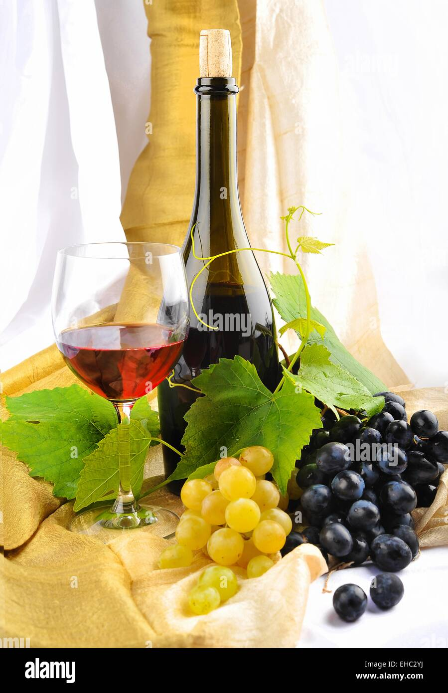 Wine and Grapes Setup with wine bottles and grapes - Stock Image