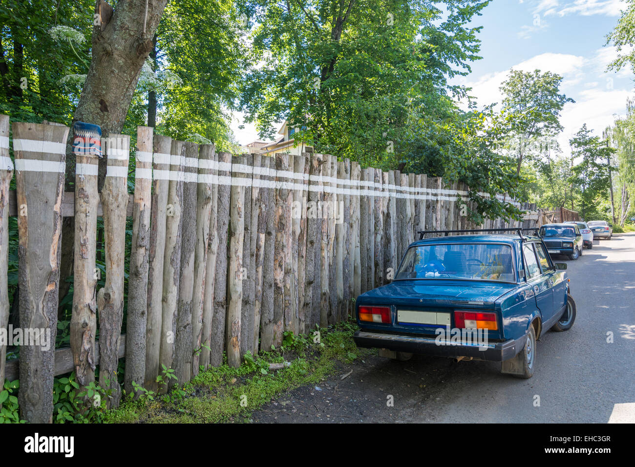 Double dividing line on an old wooden fence. - Stock Image