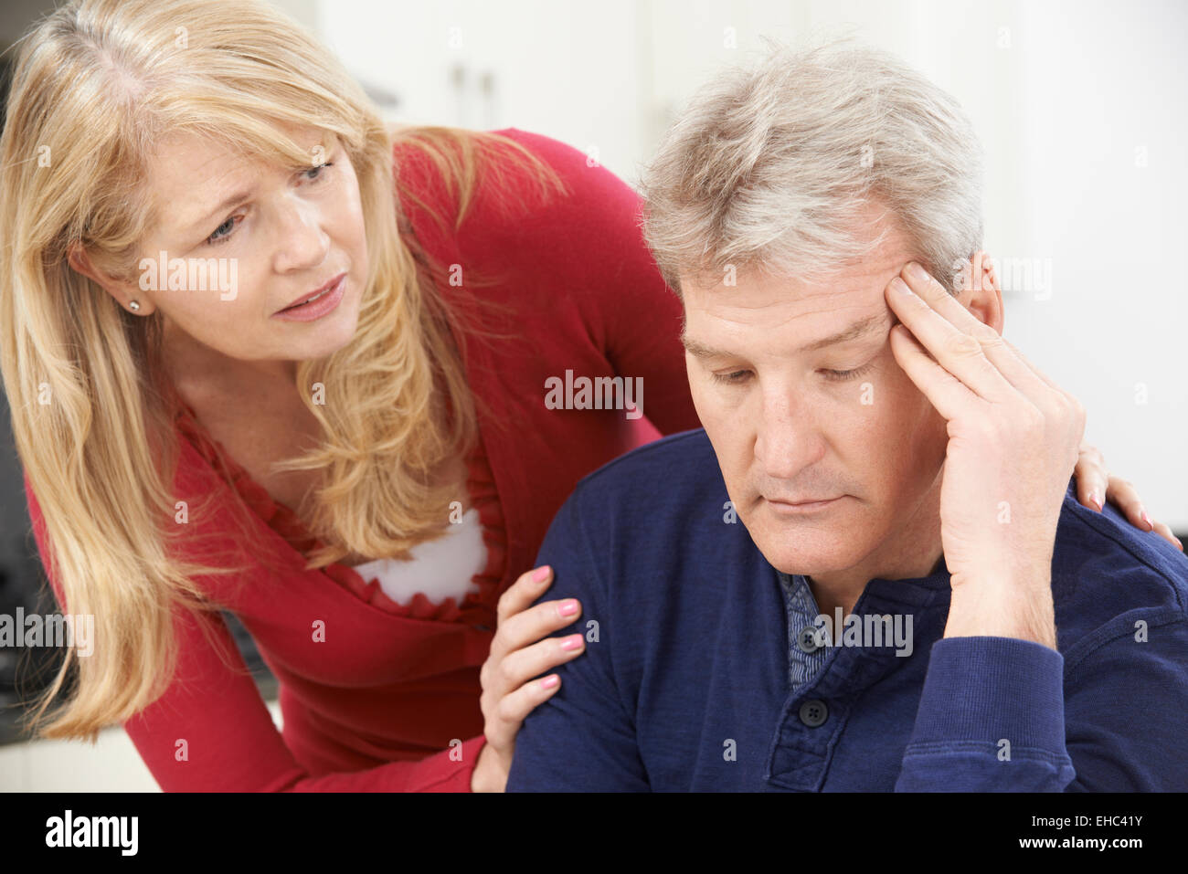 Mature Woman Comforting Man With Depression - Stock Image