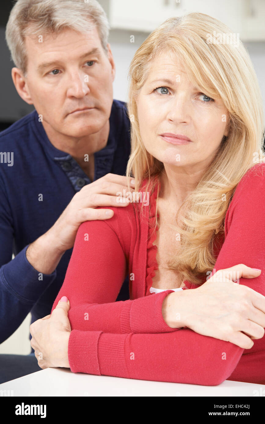 Mature Man Comforting Woman With Depression - Stock Image