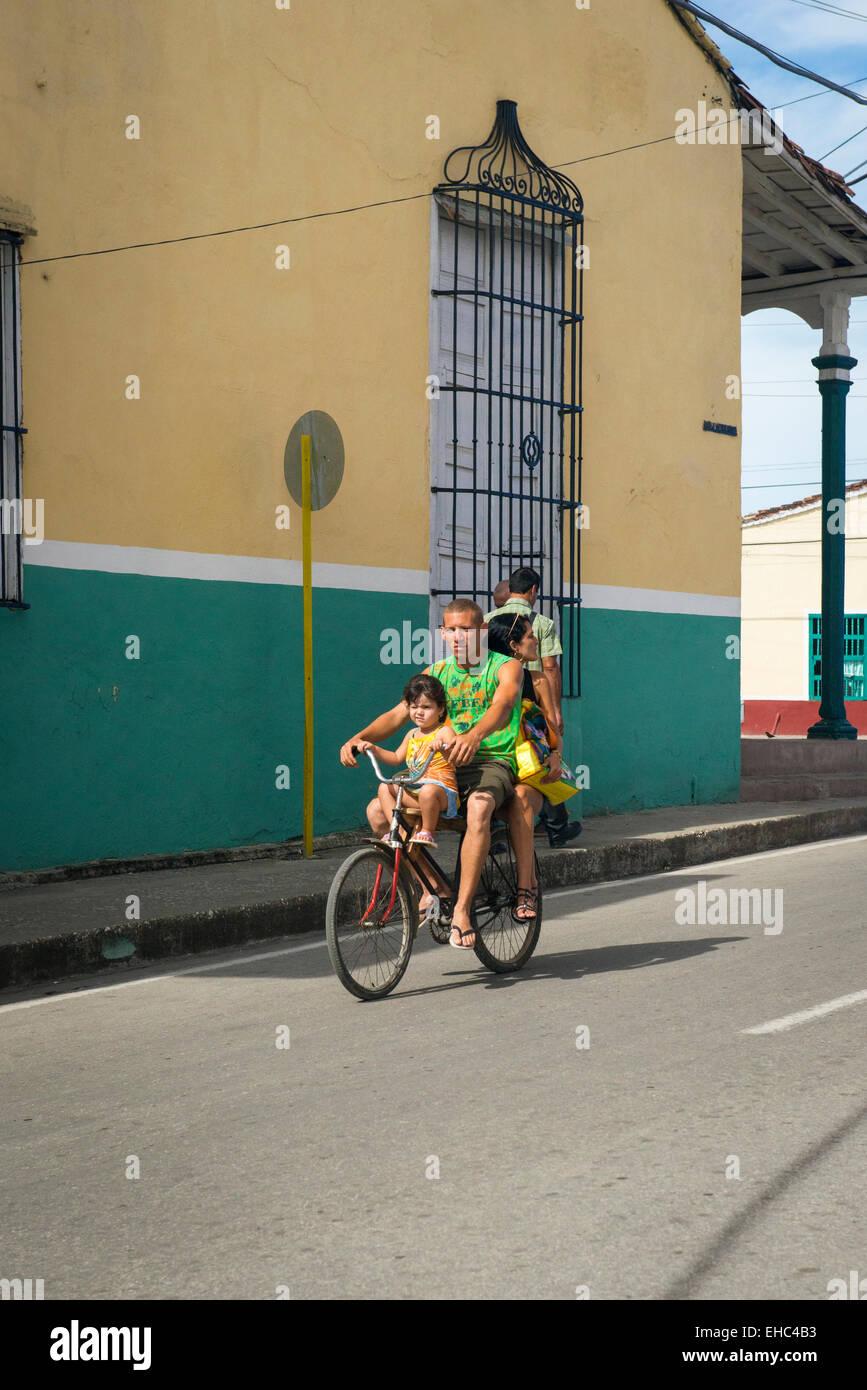 Cuba Sancti Spiritus road street scene bike bicycle cycle man father woman mother child girl daughter family outing Stock Photo