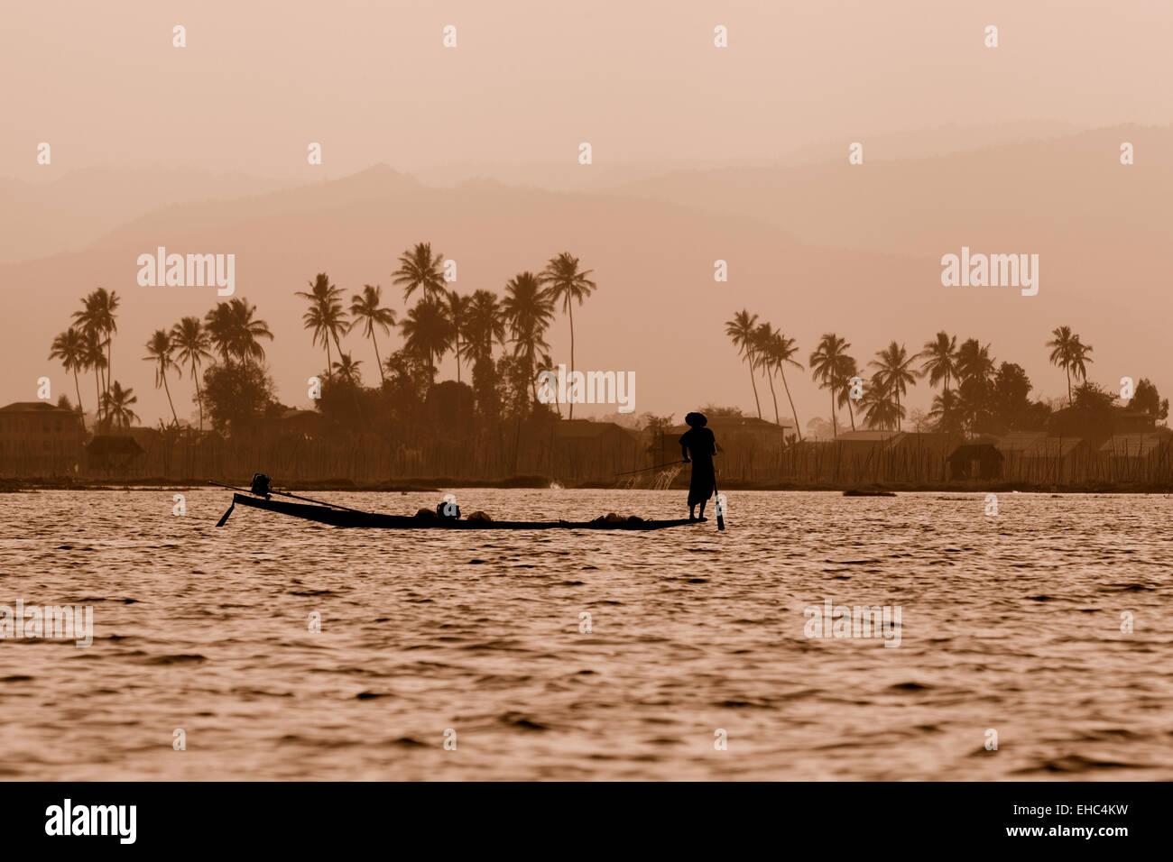 Inle lake landscape at dusk with fisherman, Inle Lake, Myanmar ( Burma ), Asia Stock Photo
