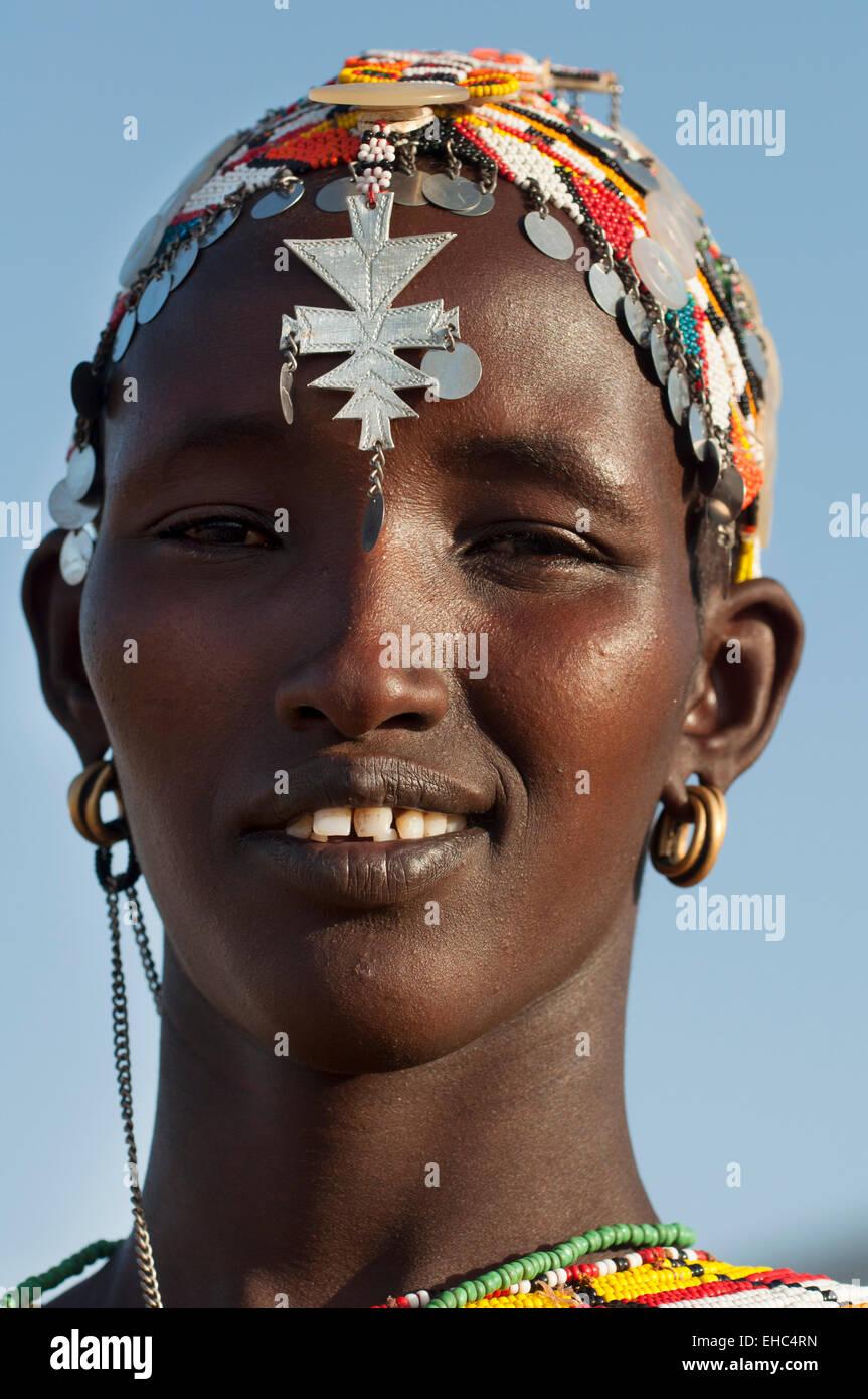 Beautiful Samburu woman with massive colorful necklaces and headdress, Leisamis area, Kenya - Stock Image