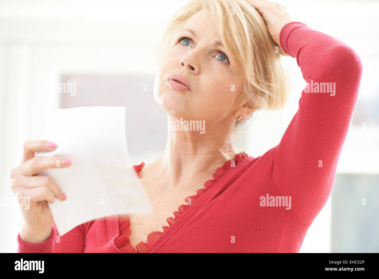 Mature Woman Experiencing Hot Flush From Menopause - Stock Image