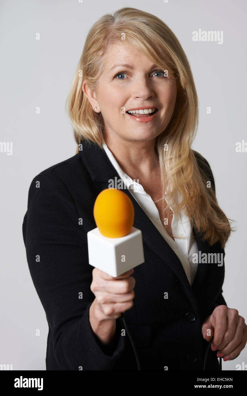 Female Journalist With Microphone On White Background - Stock Image