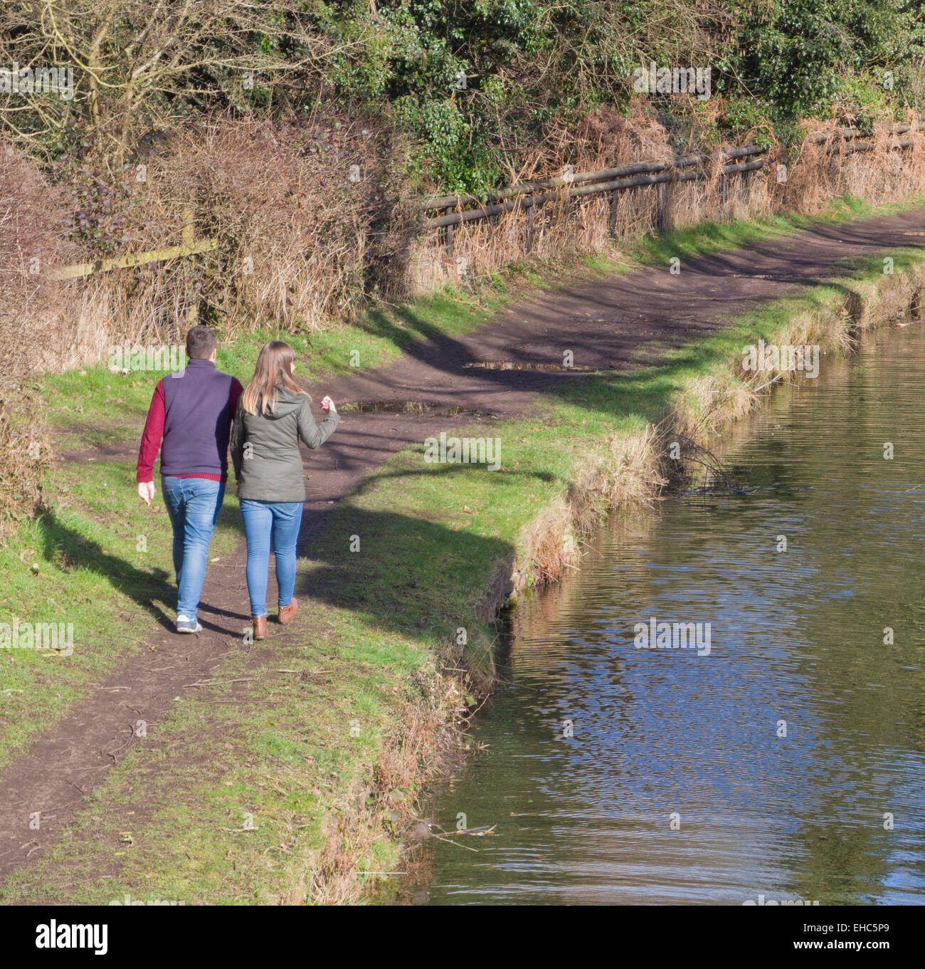 Young Caucasian Couple Waliking Along Stourbridge Canal Towpath, Staffordshire, England, UK in Winter Stock Photo