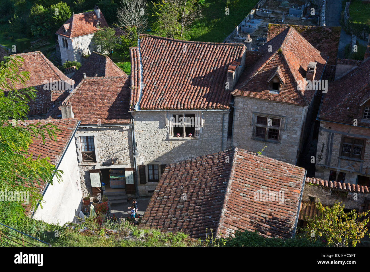 Looking down over old red roof tops of lovely stone houses in St Cirq-Lapopie village Midi-Pyrenees, Lot, Cahors, - Stock Image