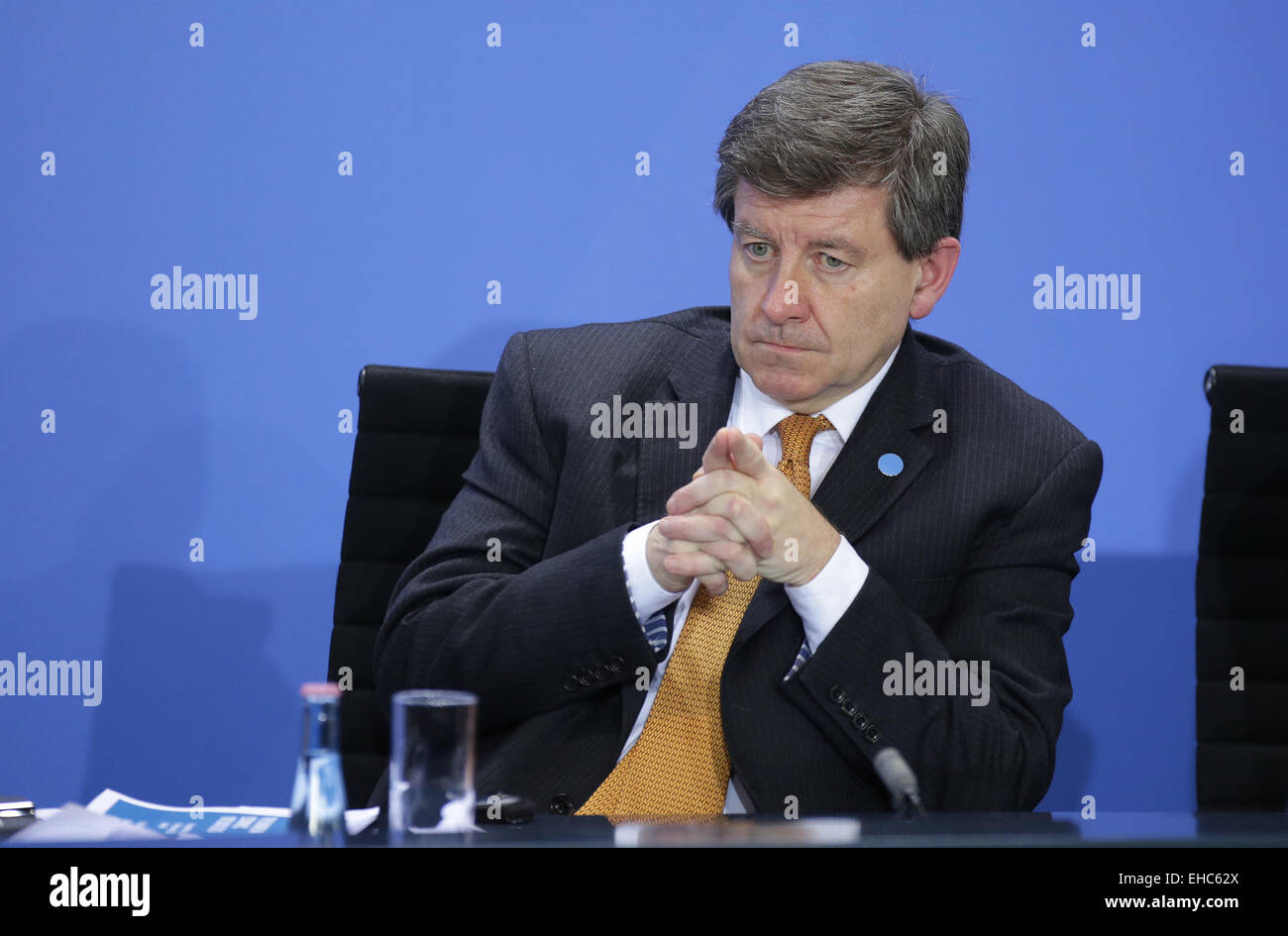 Berlin, Germany. 11th March, 2015. Guy Ryder, Director-General of the International Labour Organization (ILO) (background - Stock Image