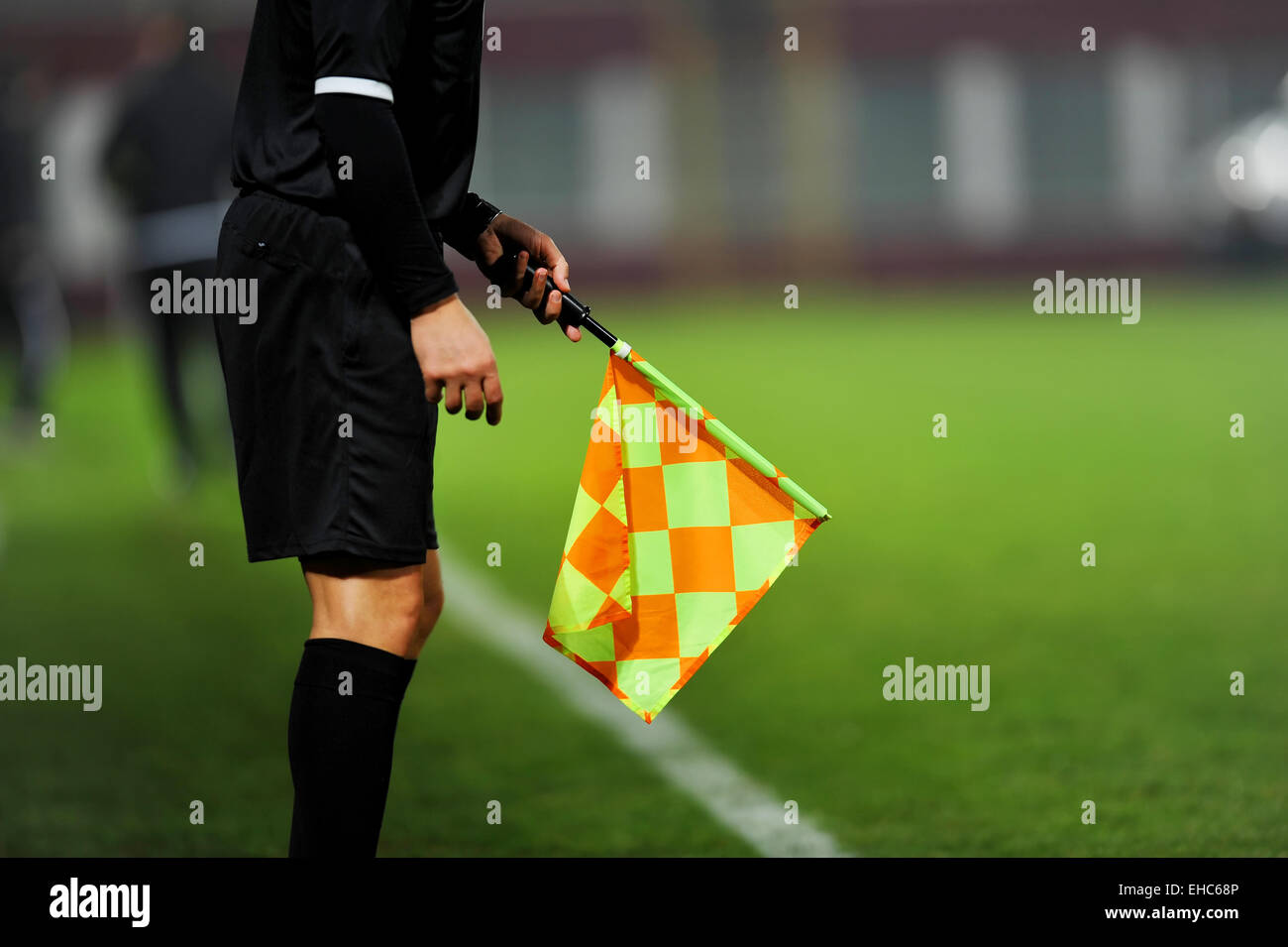 Assistant referees in action during a soccer match - Stock Image