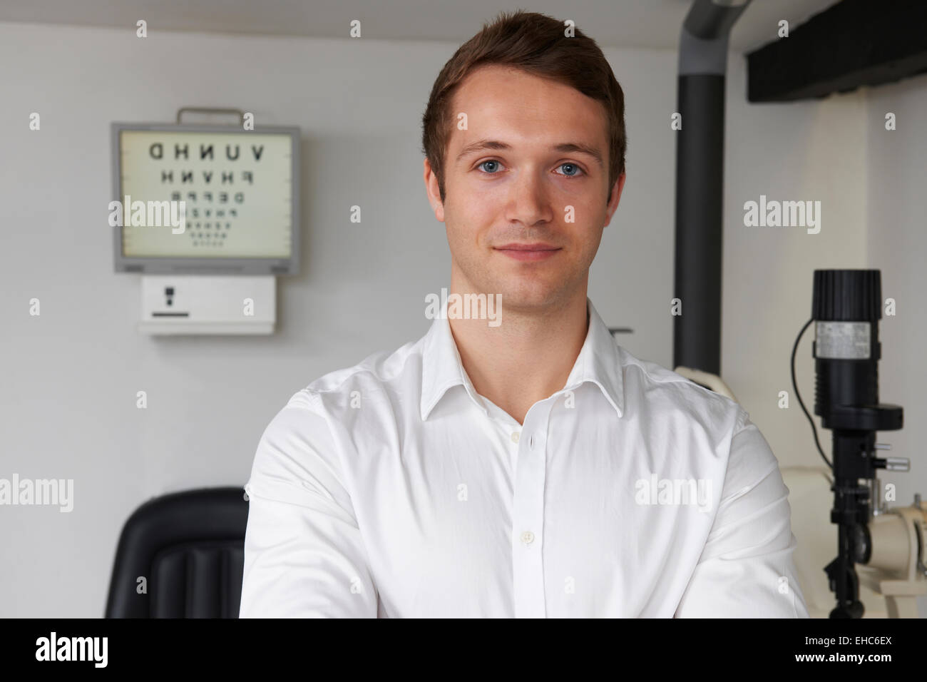 Portrait Of Male Optician In Optometrists - Stock Image