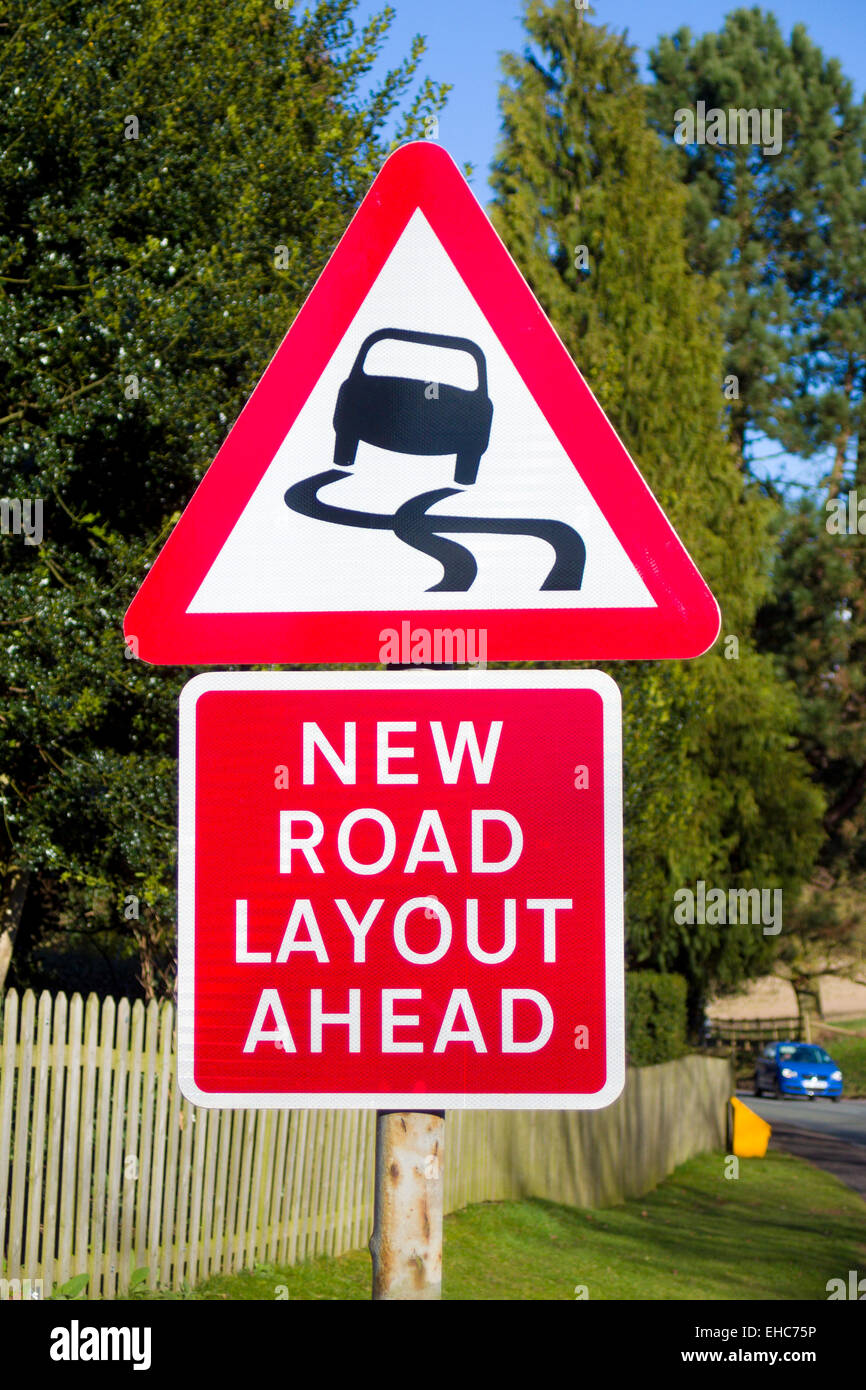 New Road Layout Ahead and Risk of Skidding Road Signs, UK - Stock Image
