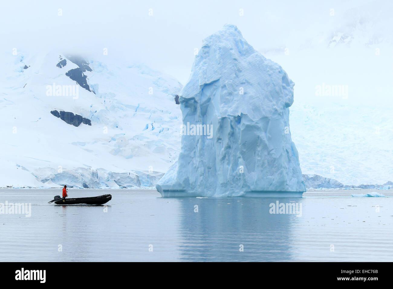 Antarctica iceberg, ice berg, floats in Antarctica landscape of ice with Zodiac driver. - Stock Image