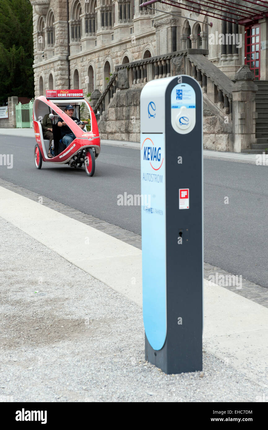Electric car charging point and bicycle for tourist in Koblenz Germany - Stock Image